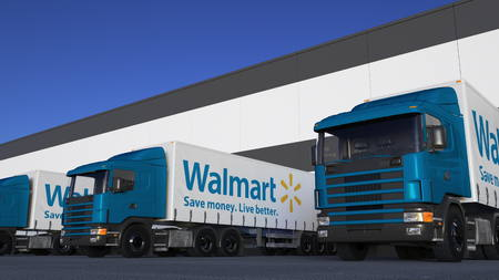 Freight semi trucks with Walmart logo loading or unloading at warehouse dock. Editorial 3D rendering Editorial