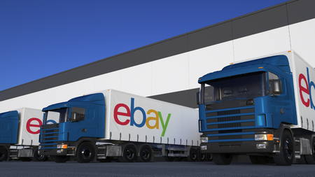 ebay: Freight semi trucks with eBay Inc. logo loading or unloading at warehouse dock. Editorial 3D rendering Editorial