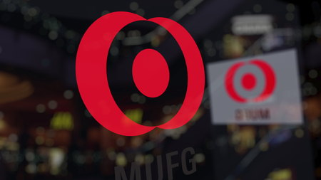 MUFG logo on the glass against blurred business center. Editorial 3D rendering