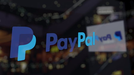 PayPal logo on the glass against blurred business center. Editorial 3D rendering