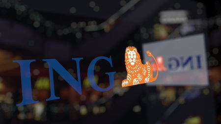 ING Group logo on the glass against blurred business center. Editorial 3D rendering Banco de Imagens - 83054181