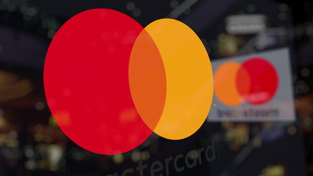 MasterCard logo on the glass against blurred business center. Editorial 3D rendering Editorial