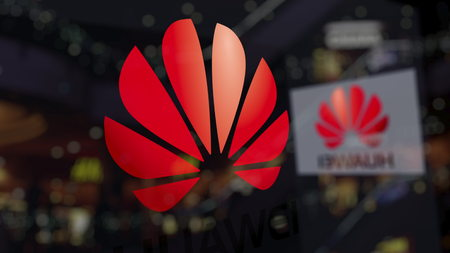Huawei logo on the glass against blurred business center. Editorial 3D rendering