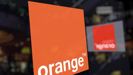 Orange S.A. logo on the glass against blurred business center. Editorial 3D rendering