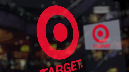 Target Corporation logo on the glass against blurred business center. Editorial 3D rendering