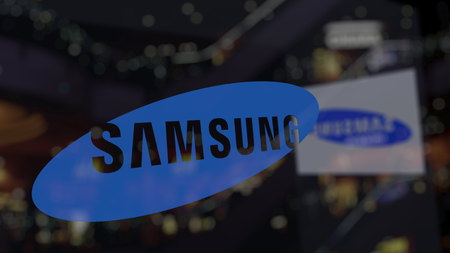 Samsung logo on the glass against blurred business center. Editorial 3D rendering Editorial