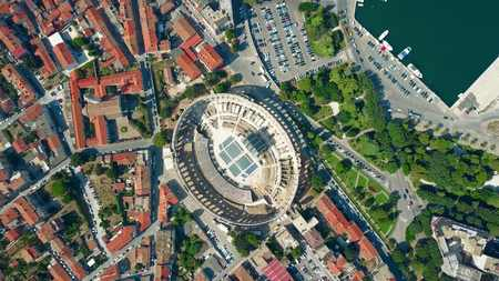 Aerial top down view of Pula city and famous ancient Roman amphitheatre in Croatia Banco de Imagens