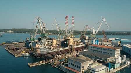 shipbuilding: PULA, CROATIA - AUGUST 4, 2017. Aerial view of the Uljanik shipyard Editorial