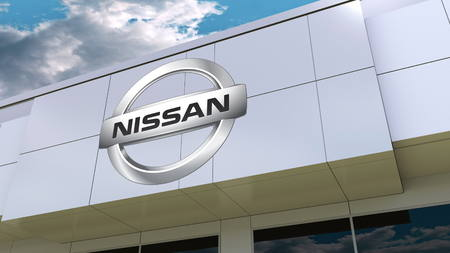 Nissan logo on the modern building facade. Editorial 3D rendering Фото со стока - 83643969
