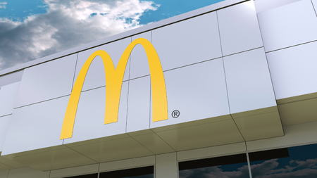McDonalds logo on the modern building facade. Editorial 3D rendering
