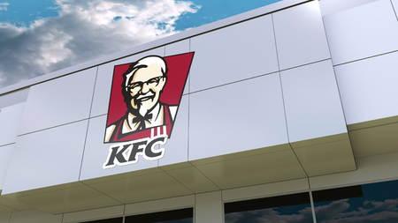 Kentucky Fried Chicken KFC logo on the modern building facade. Editorial 3D rendering