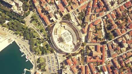 Aerial top down view of Pula city and famous ancient Roman arena in Croatia, one of the most popular Croatian landmarks