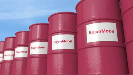 Row of metal barrels ExxonMobil Corporation logo against sky, editorial 3D rendering