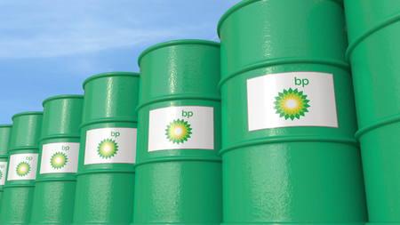 Row of metal barrels with BP P.L.C. logo against sky, editorial 3D rendering Editorial