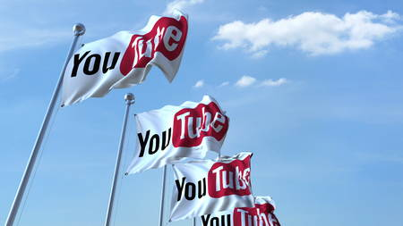 Waving flags with Youtube logo against sky, editorial 3D rendering Editorial