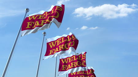 Waving flags with Wells Fargo logo against sky, editorial 3D rendering Editorial