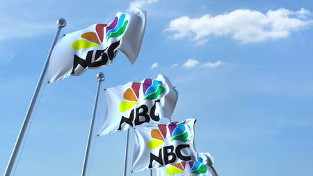 Waving flags with NBC logo against sky, editorial 3D rendering