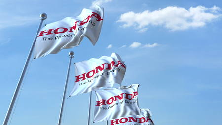 Waving flags with Honda logo against sky, editorial 3D rendering Editorial