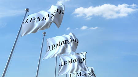 Waving flags with J.P. Morgan logo against sky, editorial 3D rendering