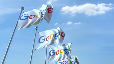 Waving flags with Google logo against sky, editorial 3D rendering 에디토리얼