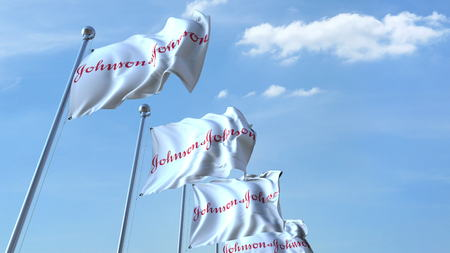 Waving flags with Johnson&Johnson logo against sky, editorial 3D rendering Editorial