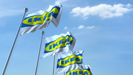 Waving flags with Ikea logo against sky, editorial 3D rendering Editorial