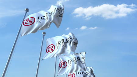 Waving flags with ICBC logo against sky, editorial 3D rendering