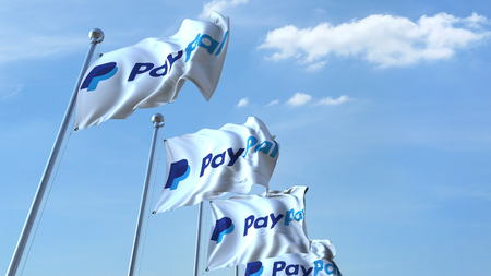 paypal: Waving flags with Paypal logo against sky, editorial 3D rendering