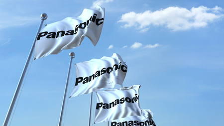 Waving flags with Panasonic logo against sky, editorial 3D rendering