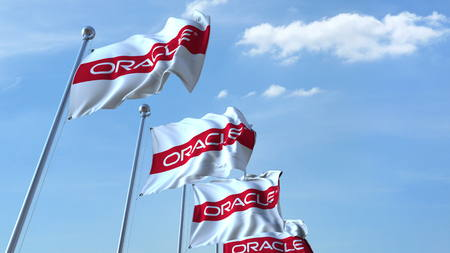 Waving flags with Oracle logo against sky, editorial 3D rendering