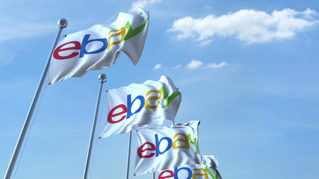 ebay: Waving flags with Ebay logo against sky, editorial 3D rendering Editorial