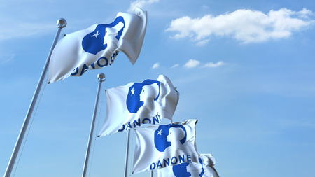 Waving flags with Danone logo against sky, editorial 3D rendering Editorial