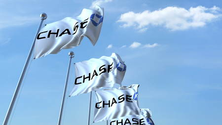Waving flags with Chase logo against sky, editorial 3D rendering Editorial