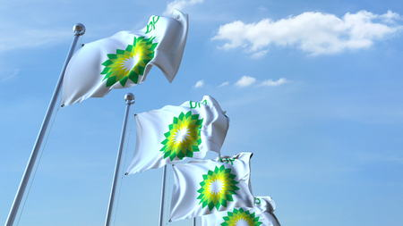 Waving flags with BP logo against sky, editorial 3D rendering