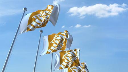 Wapperende vlaggen met het Home Depot-logo tegen hemel, redactionele 3D-weergave Redactioneel