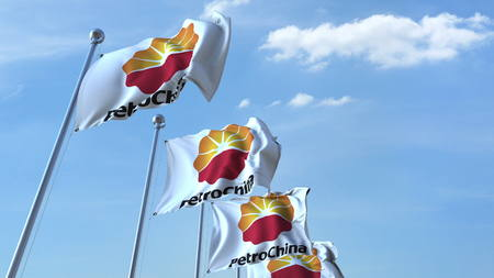Waving flags with Petrochina logo against sky, editorial 3D rendering
