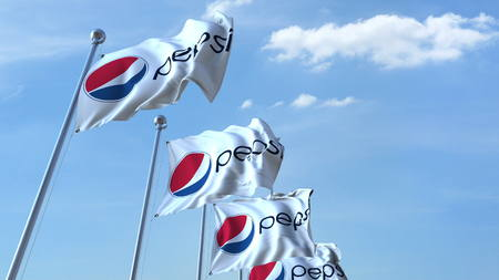 Waving flags with Pepsi logo against sky, editorial 3D rendering Editorial