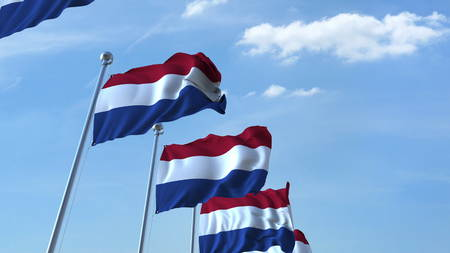 Row of waving flags of the Netherlands agaist blue sky, 3D rendering Stock Photo