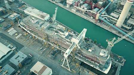 Aerial shot of modern hi-tech cruise ship under construction at the shipyard Stok Fotoğraf