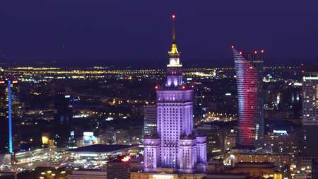 WARSAW, POLAND - AUGUST 26, 2017. Aerial shot of downtown high-rise buildings illuminated at night
