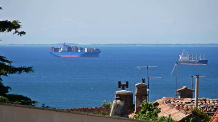 Distant container cargo ships in the sea harbour