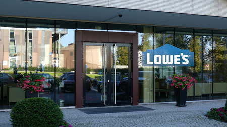Glass facade of a modern office building with Lowes logo. Editorial 3D rendering