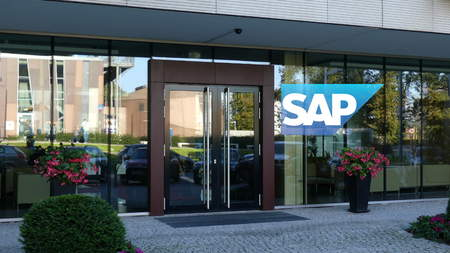 Glass facade of a modern office building with SAP SE logo. Editorial 3D rendering