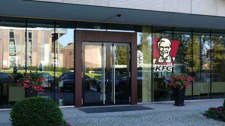 Glass facade of a modern office building with Kentucky Fried Chicken KFC logo. Editorial 3D rendering