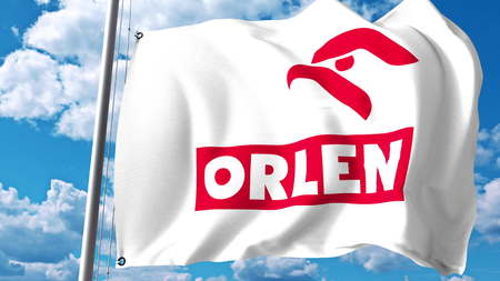 Waving flag with PKN Orlen logo against clouds and sky. Editorial 3D rendering