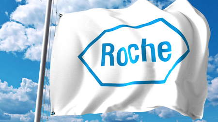 Waving flag with Hoffmann-La Roche logo against clouds and sky. Editorial 3D rendering