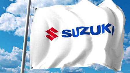 Waving flag with Suzuki Motor logo against clouds and sky. Editorial 3D rendering