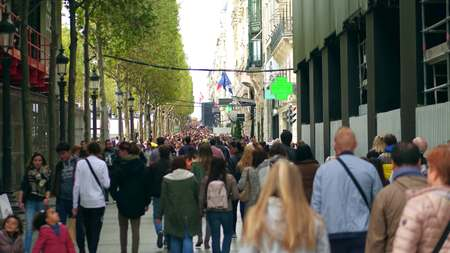 clutter: PARIS, FRANCE - OCTOBER 7, 2017. Walk along crowded famous Champs-Elysees street