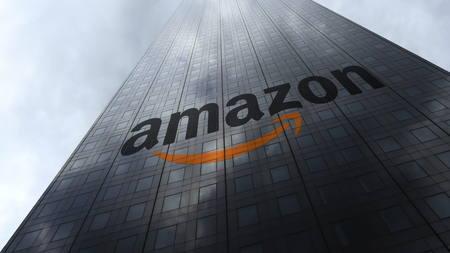 Amazon.com logo on a skyscraper facade reflecting clouds. Editorial 3D rendering