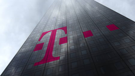 T-Mobile logo on a skyscraper facade reflecting clouds. Editorial 3D rendering Editorial